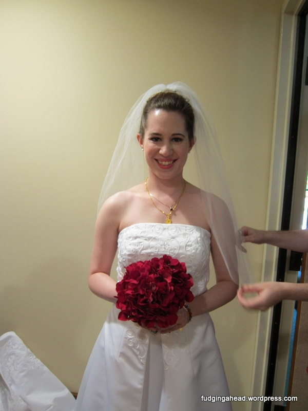 I had to share this picture because it shows where I put on this dress...it was in the confessional room of the church.